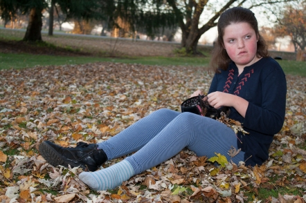 ASHBURN, Ont., (03/11/15) - Ellie Howe, 12 has autism, but that does not stop her enjoying the warm fall weather. Here she is having fun at her home among the fallen leaves. Phot by, Barbara Howe, Durham College