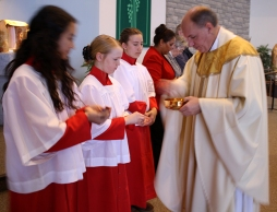 BROOKLIN, Ont. (22/11/2015) - Fr. Charles distributes communion to the alterservers and the Eucharistic Ministers. Photo by Barbara Howe, Durham College, Oshawa