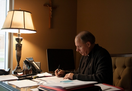 BROOKLIN, Ont. (22/11/2015) - Fr. Charles attending to some of the administative duties. This includes a fundraising campaigne for the parish and the diocese. Photo by Barbara Howe, Durham College, Oshawa
