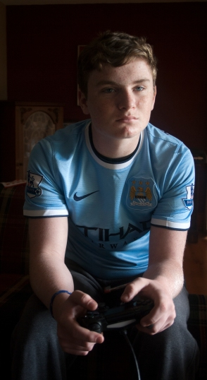 ASHBURN, Ont. ( 25/10/15) - Liam Howe, 14 likes to live in the virtual world. He loves to play sports video games. He even gets to wear his favourite team's uniform while he does it. Photo by Barbara Howe, Durham College