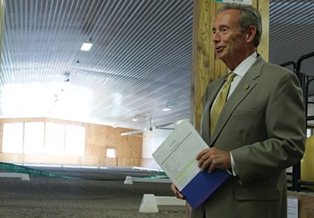 Whitby-Oshawa MPP Lorne Coe speaking at the opening ceremony of the newly renovated indoor riding arena at Windreach Farm in Ashburn. Phot by Barbara Howe