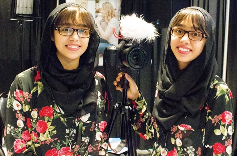 "Twins Maryam and Nivaal Rehman Grade 10 students from Sinclair High School, Whitby attended WE Day while shooting video for their YouTube channel ""The Worrld With MNR."" Photo by Barbara Howe"