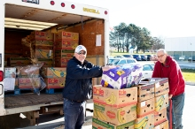 Phil Bilinski,and Ray Bottrell from Feed the Need in Durham unload this week's delivery of food and supplies for the Food Centre at the Simcoe Buildingat DC. Photo by Barbara Howe