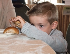 Three-year-old Bennett Fraser from Whitby enjoys his bread roll between mouthfuls of soup at the Feed the Need in Durham Empty Bowls event. Photo by Barbara Howe