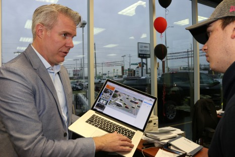Craig Campbell shows Michael Welsh, journalism student, innovation in GMs vehicles. Photo by Barbara Howe