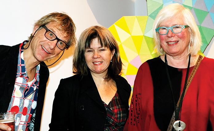 "Karl Apple (Left) and Adrienne Trent (centre) pictured with Artist Judith Tinkl stand in front of Tinkl'e piece ""Piece by Piece"" (acrylic on masonite 2010)."