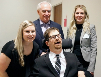 Katie Hughes (Left) and John Draper (centre) from Together We Rock! with Leo Plue and Heather St. Amand (Rear) from the Abilities Centre at ab inclusive workplaces workshop. Photo by Barbara Howe.