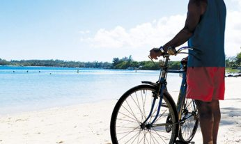 cropped-cropped-manwithbikeonbeach.jpg