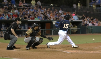 Robert Garcia #15 swings for Myrtle Beach Pelicans v Down East Wood Ducks